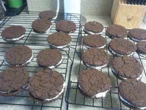 Photo of nearly twenty chocolate sandwich cookies with vanilla cream filling.