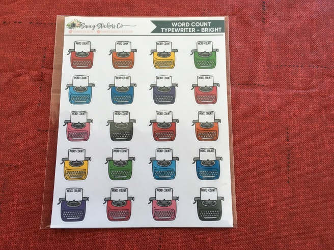 A sheet of stickers. It includes multicolored typewriters reading 'word count'