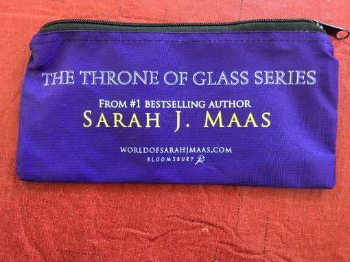 Pencil bag that reads 'The Throne of Glass Series, From #1 Bestselling Author Sarah. J. Maas, worldofsarahjmaas.com, Bloomsbury.'