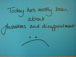 Notecard that reads 'Today has mostly been about frustrations and disappointment :('